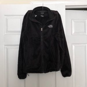 Black fuzzy north face jacket